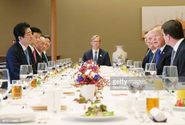 US President Donald Trump second right and Shinzo Abe Japan's Prime Minister left attend a working lunch at Akasaka Palace in Tokyo Japan on Monday...