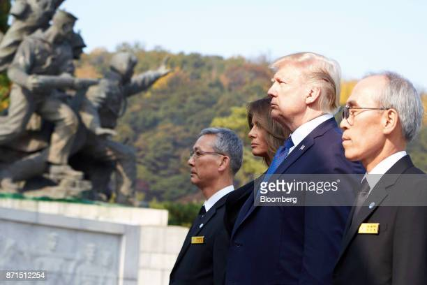 US President Donald Trump second right and US First Lady Melania Trump third right participate in a wreathlaying ceremony at the National Cemetery in...