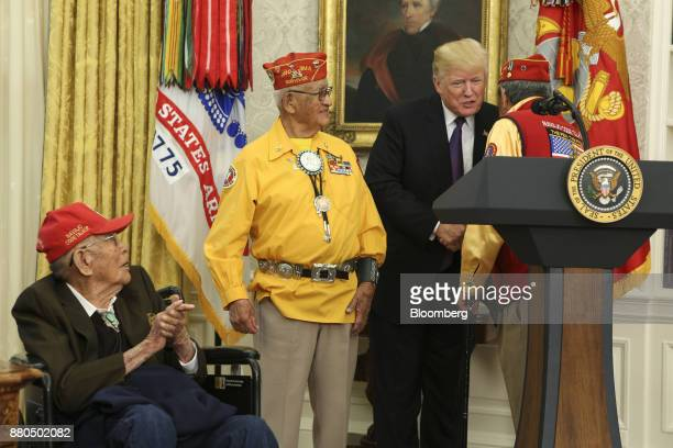 US President Donald Trump second right shakes hands with a World War II veteran during an event honoring Native American 'Code Talkers' inside the...