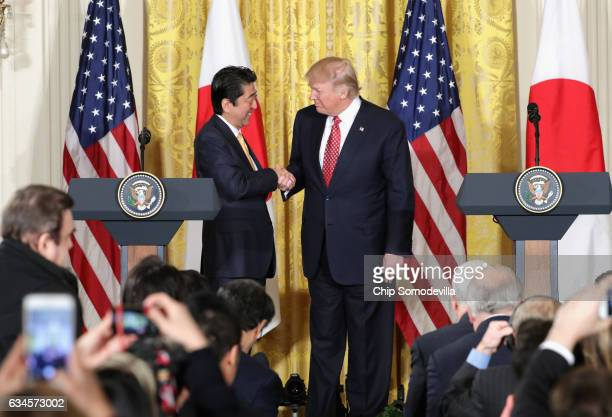 S President Donald Trump shake hands during a joint press conference with Japan Prime Minister Shinzo Abe in the East Room at the White House on...
