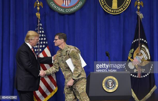 US President Donald Trump shakes hands with CENTCOM Commander Joseph Votel as he arrives on stage to speak following a visit to the US Central...