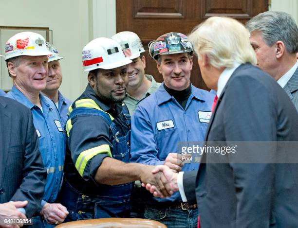 S President Donald Trump shakes hands with coal miners prior to signing HJ Res 38 disapproving the rule submitted by the US Department of the...