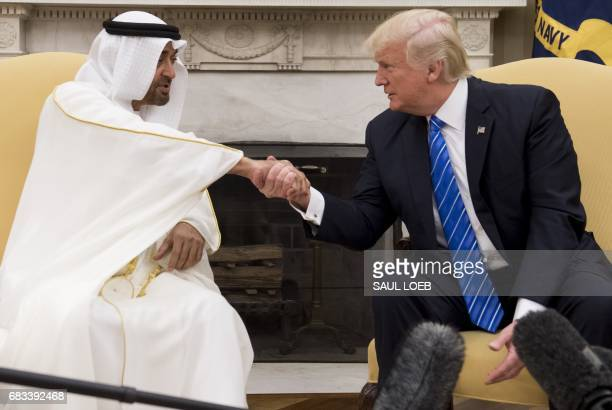 US President Donald Trump shakes hands with Crown Prince Mohammed Bin Zayed Al Nahyan of Abu Dhabi during a meeting in the Oval Office of the White...
