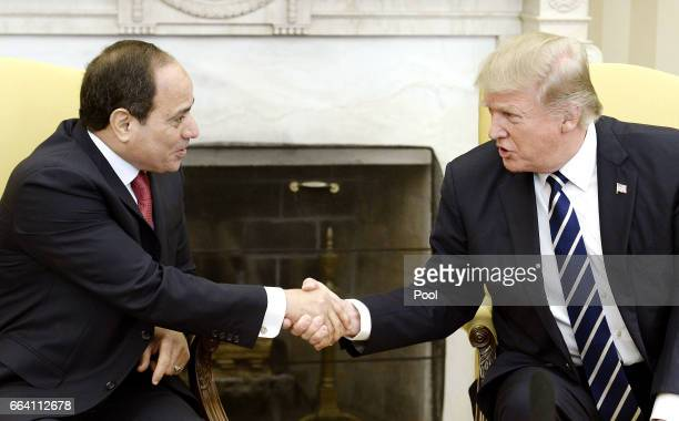 US President Donald Trump shakes hands with Egyptian President Abdel Fattah Al Sisi in the Oval Office of the White House on April 3 2017 in...