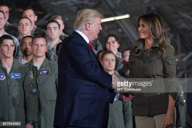 US President Donald Trump shakes hands with First Lady Melania Trump after she introduced him before his address to military personnel and families...