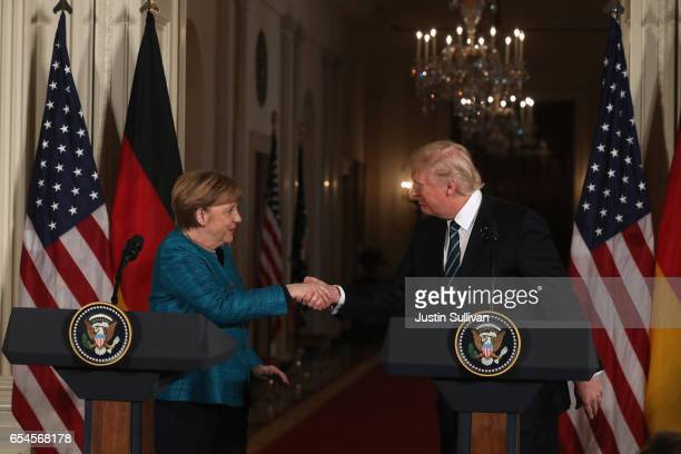 S President Donald Trump shakes hands with German Chancellor Angela Merkel during a joint press conference in the East Room of the White House on...