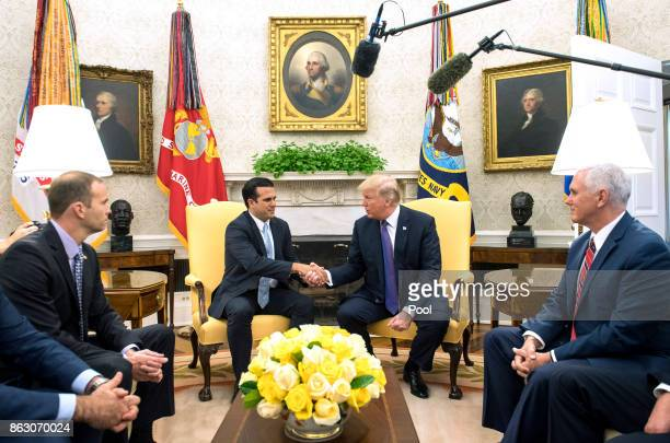 President Donald Trump shakes hands with Governor Ricardo Rossello of Puerto Rico during a meeting in the Oval Office at the White House on October...