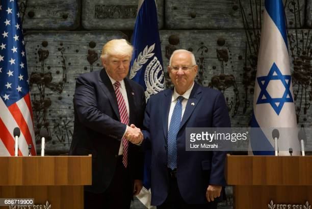 US President Donald Trump shakes hands with Israel's President Reuven Rivlin during a visit to the President's House on May 22 2017 in Jerusalem...