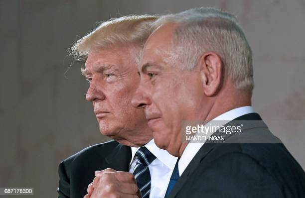 US President Donald Trump shakes hands with Israel's Prime Minister Benjamin Netanyahu after speaking at the Israel Museum in Jerusalem on May 23...
