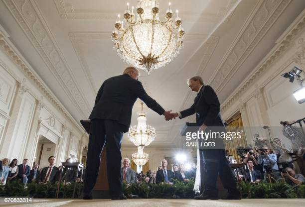 US President Donald Trump shakes hands with Italian Prime Minister Paolo Gentiloni during a press conference in the East Room at the White House in...