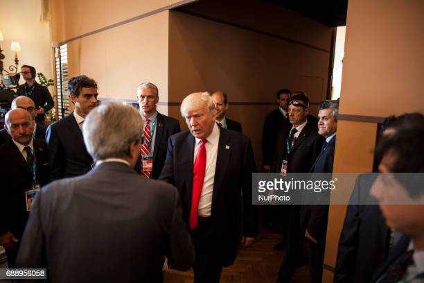 US President Donald Trump shakes hands with italian Prime Minister Paolo Gentiloni at the G7 Summit expanded session in Taormina Sicily on May 27 2017