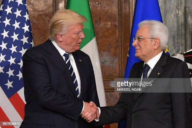 US President Donald Trump shakes hands with Italy's President Sergio Mattarella prior their meeting at the Quirinale Presidential Palace on May 24...