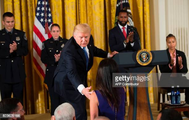 US President Donald Trump shakes hands with Jennifer Scalise wife of US House Majority Whip Representative Steve Scalise Republican of Louisiana...