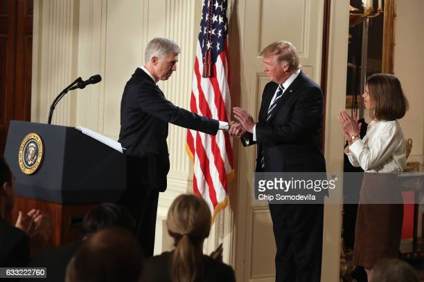 S President Donald Trump shakes hands with Judge Neil Gorsuch after nominating him to the Supreme Court during a ceremony in the East Room of the...
