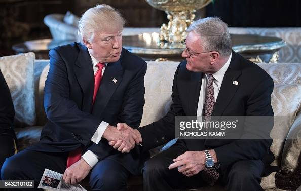 US President Donald Trump shakes hands with Keith Kellogg after announcing him as chief of staff to national security adviser US Army Lieutenant...