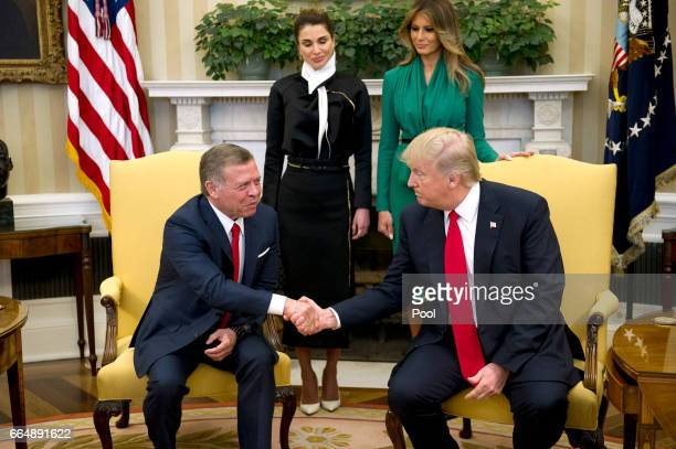 US President Donald Trump shakes hands with King Abdullah II of Jordan in the Oval Office of the White House on April 5 2017 in Washington DC...