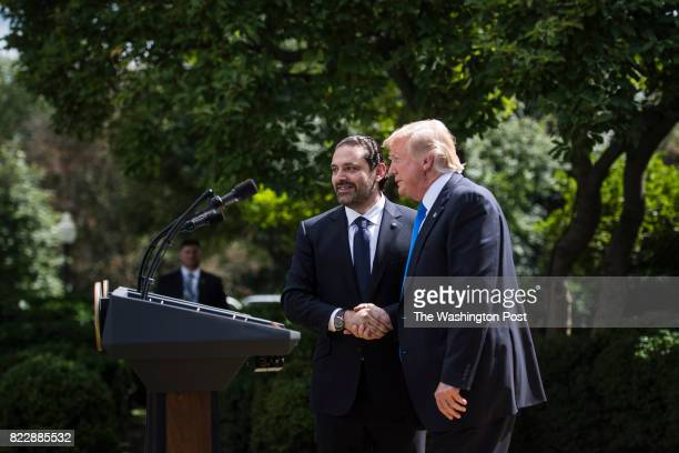 President Donald Trump shakes hands with Lebanese Prime Minister Saad Hariri during a joint news conference in the Rose Garden at the White House in...