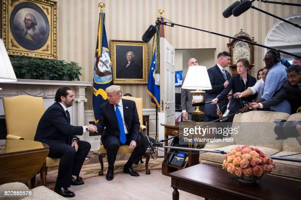President Donald Trump shakes hands with Lebanese Prime Minister Saad Hariri during a meeting in the Oval Office at the White House in Washington DC...