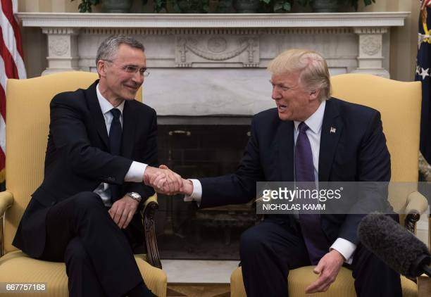 US President Donald Trump shakes hands with NATO Secretary General Jens Stoltenberg in the Oval Office at the White House in Washington DC on April...