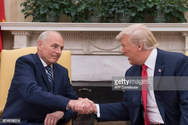President Donald Trump shakes hands with newly swornin White House Chief of Staff John Kelly at the White House in Washington DC on July 31 2017 US...