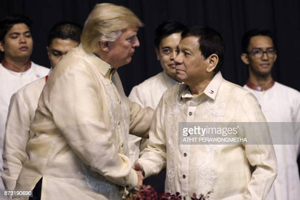 US President Donald Trump shakes hands with Philippines President Rodrigo Duterte during a special gala celebration dinner for the Association of...