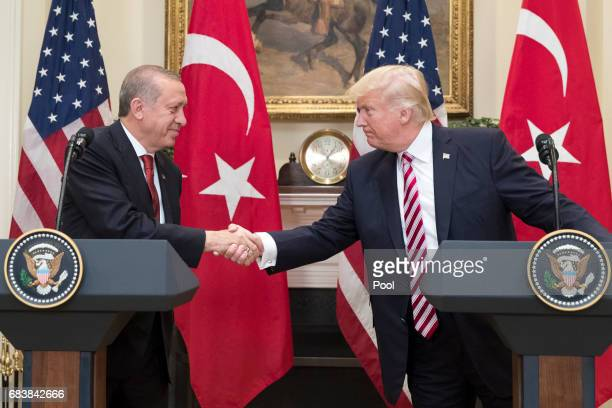 President Donald Trump shakes hands with President of Turkey Recep Tayyip Erdogan in the Roosevelt Room where they issued a joint statement at the...