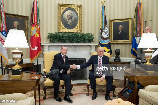 President Donald Trump shakes hands with President of Turkey Recep Tayyip Erdogan in the Oval Office of the White House on May 16 2017 in Washington...