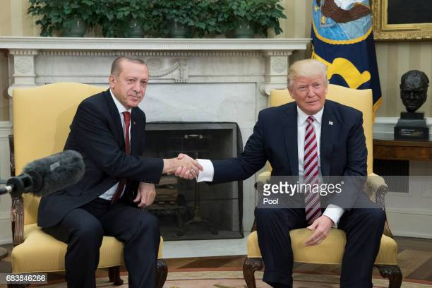 President Donald Trump shakes hands with President of Turkey Recep Tayyip Erdogan in the Oval Office of the White Houseon May 16 2017 in Washington...