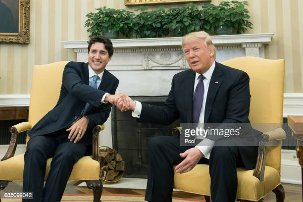 US President Donald Trump shakes hands with Prime Minister Justin Trudeau of Canada during a meeting in the Oval Office at the White House on...