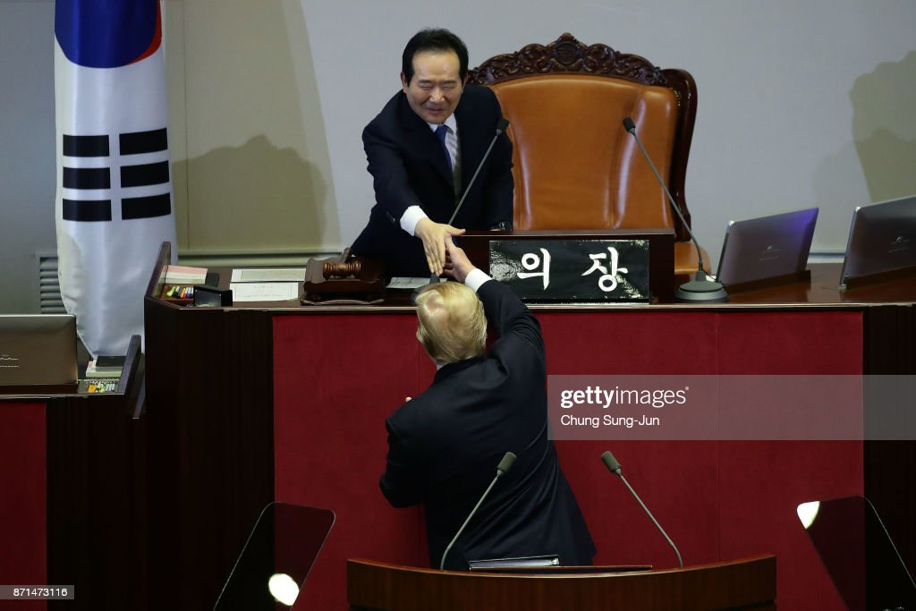 U.S. President Donald Trump shakes hands with speaker of South Korean national assembly Chung Sye-Kyun after speech at the National Assembly on November 8, 2017 in Seoul, South Korea. Trump is in South Korea as a part of his Asian tour.