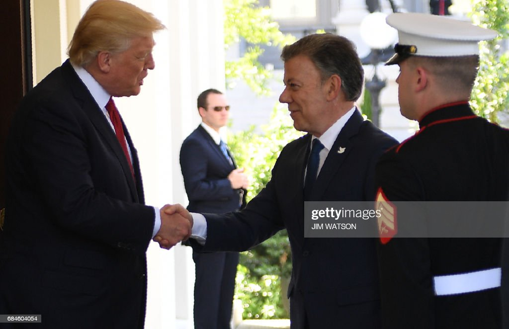US President Donald Trump (L) shakes hands with the President of Colombia Juan Manuel Santos as he arrives at the White House in Washington, DC on May 18, 2017. /