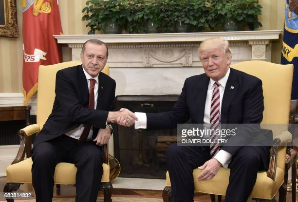 US President Donald Trump shakes hands with Turkish President Recep Tayyip Erdogan during a meeting in the Oval Office of the White House in...