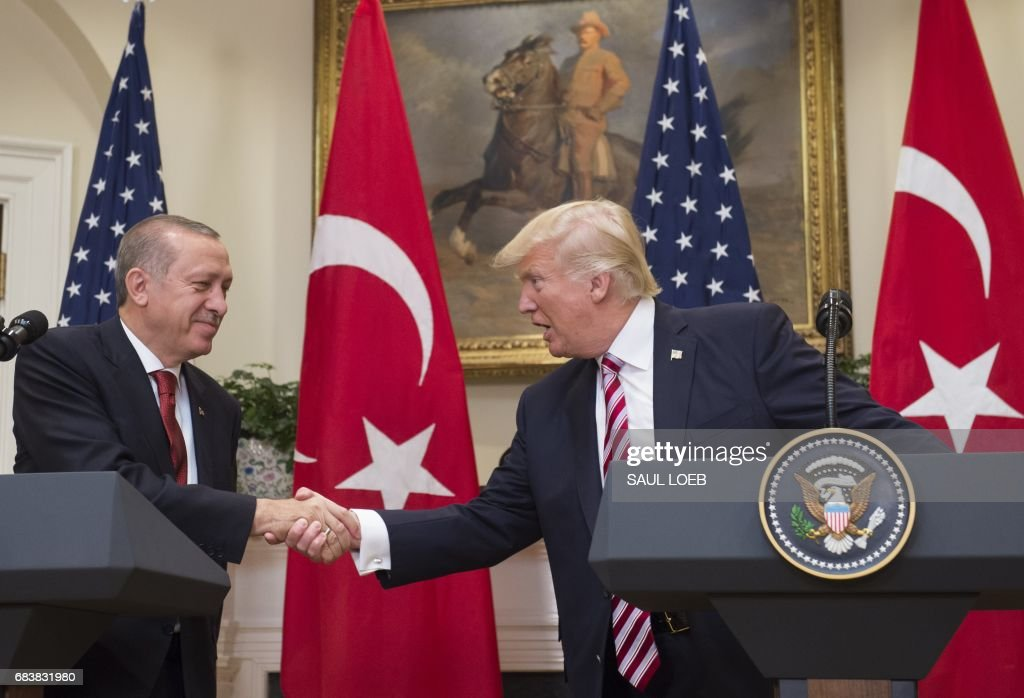 US President Donald Trump shakes hands with Turkish President Recep Tayyip Erdogan after speaking to the press in the Roosevelt Room of the White House in Washington, DC, May 16, 2017. /