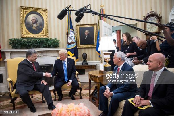 President Donald Trump shakes hands with Ukrainian President Petro Poroshenko during a meeting in the Oval Office of the White House in Washington DC...