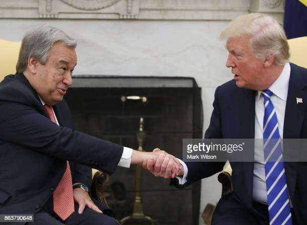 President Donald Trump shakes hands with UN Secretary General António Guterres during a meeting in the Oval office at the White House on October 20...