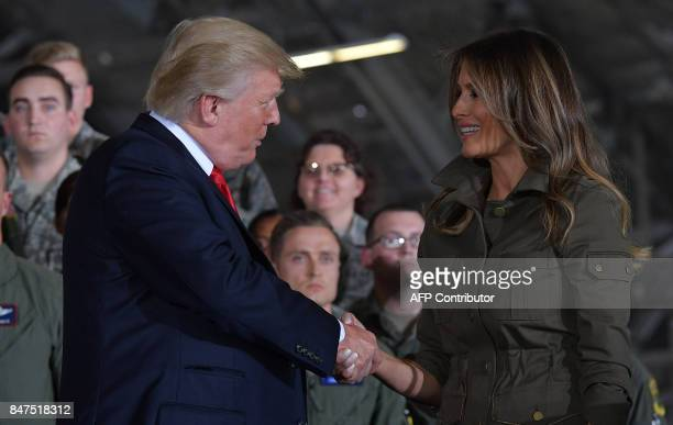 US President Donald Trump shakes hands with US First Lady Melania Trump after she spoke to members of the military at Joint Andrews Airforce base...