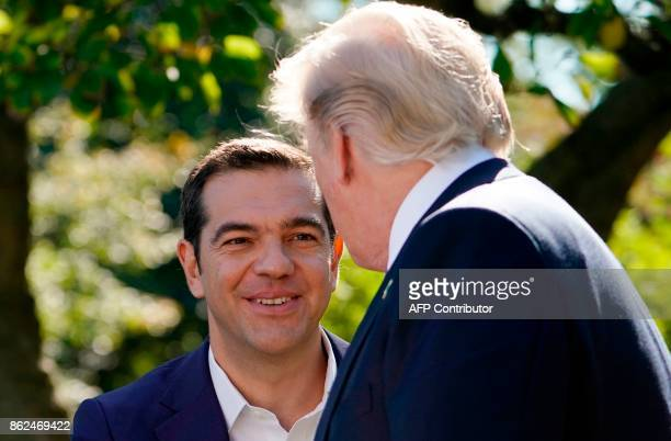 US President Donald Trump shakes hands with with Greek Prime Minister Alexis Tsipras following a press conference in the Rose Garden of the White...