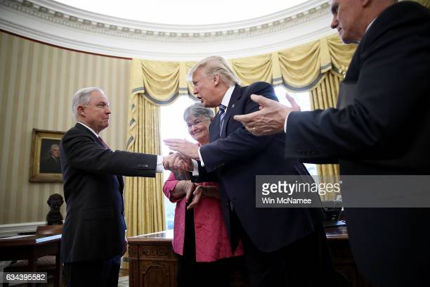 S President Donald Trump shakes the hand of Jeff Sessions after Sessions was sworn in as the new US Attorney General by US Vice President Mike Pence...