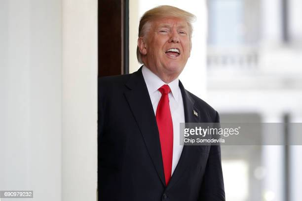 S President Donald Trump shouts answers to reporters after Vietnamese Prime Minister Nguyen Xuan Phuc left the White House following meetings May 31...