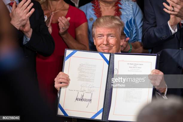President Donald Trump signed the Department of Veterans Affairs Accountability and Whistleblower Protection Act of 2017 in the East Room of the...