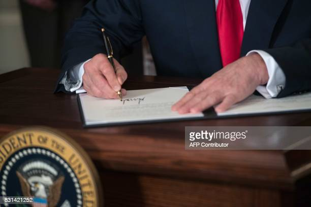 US President Donald Trump signs a memorandum on addressing Chinas laws policies practices and actions related to intellectual property innovation and...