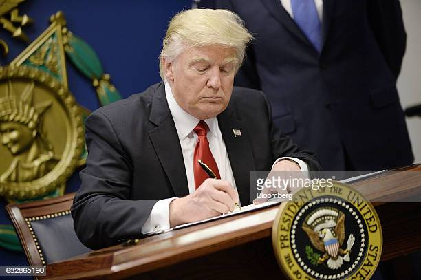 US President Donald Trump signs Executive Orders in the Hall of Heroes at the Department of Defense in Virginia January 27 2017 Photo by Olivier...