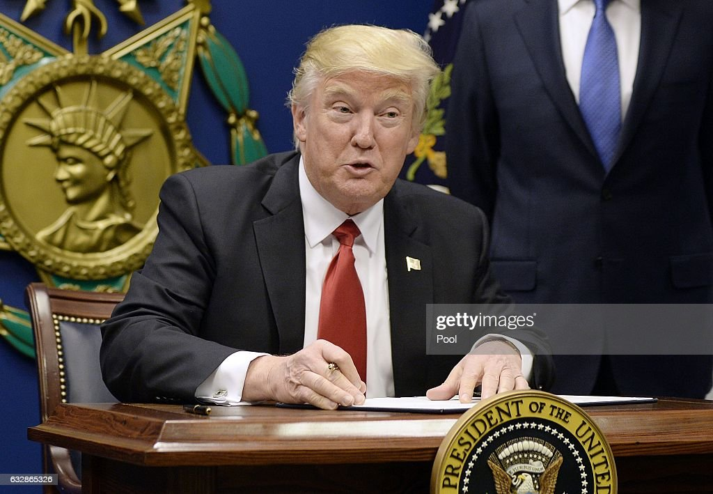 US President Donald Trump signs executive orders in the Hall of Heroes at the Department of Defense on January 27, 2017 in Arlington, Virginia. Trump signed two orders calling for the 'great rebuilding' of the nation's military and the 'extreme vetting' of visa seekers from terror-plagued countries.