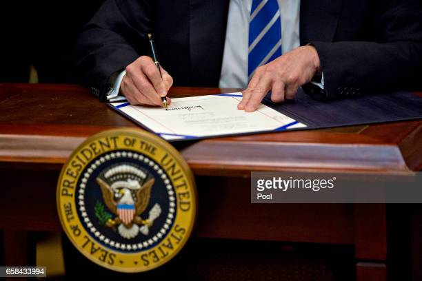 US President Donald Trump signs HJ Res 57 which overturns a rule on school accountability standards that are part of the Every Student Succeeds Act...