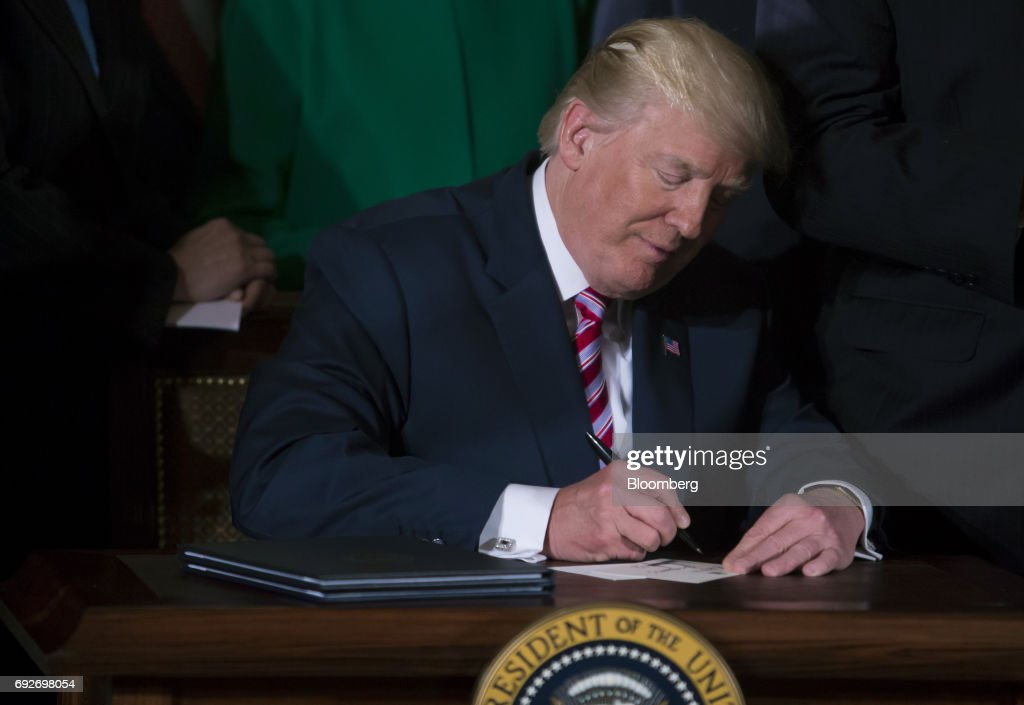 U.S. President Donald Trump signs the Air Traffic Control Reform Initiative during a press conference in the East Room of the White House in Washington, D.C., U.S., on Monday, June 5, 2017. Trump on Monday unveiled his proposal to hand over control of the U.S. air-traffic control system to a non-profit corporation, calling the current system an antiquated mess that doesnt work and wastes money. Photographer: Eric Thayer/Bloomberg via Getty Images