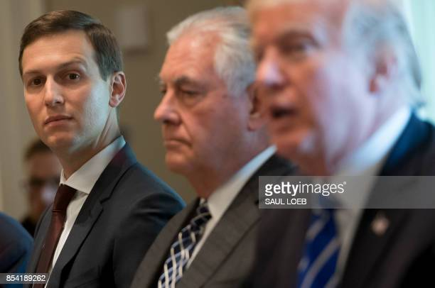 US President Donald Trump sits alongside US Secretary of State Rex Tillerson and Senior Adviser Jared Kushner during a working lunch with Spanish...