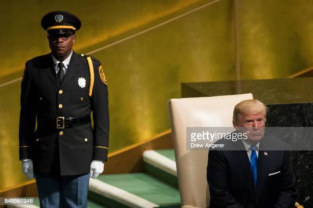 S President Donald Trump sits as he waits to be escorted from the stage after he addressed the United Nations General Assembly at UN headquarters...