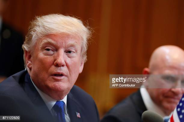 US President Donald Trump sits beside National Security Advisor HR McMaster as he talks with South Korea's President Moon JaeIn during their summit...