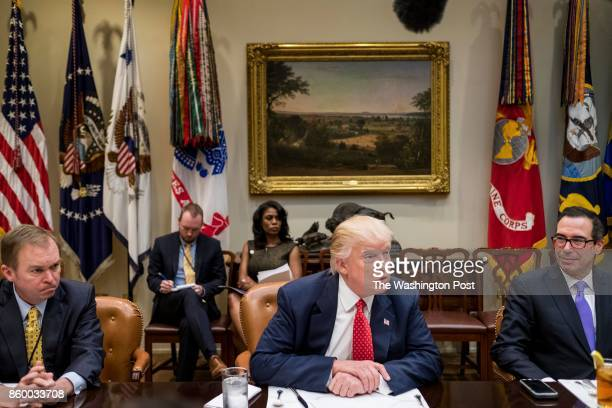 WASHINGTON DC President Donald Trump sits down with staff ranked by Budget Director Mick Mulvaney and Secretary of the Treasury Steven Mnuchin during...