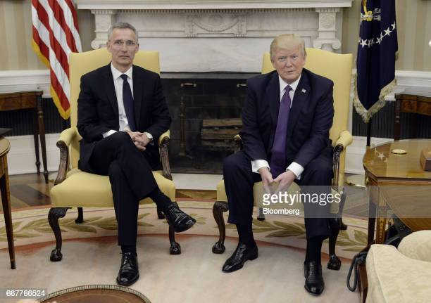 US President Donald Trump sits during a meeting with Jens Stoltenberg secretary general of the North Atlantic Treaty Organization right in the oval...